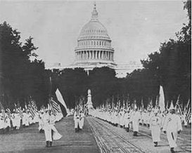 1920s the kkk essay The appeal of the klan spread to the north and west, and at its peak in the mid- 1920s achieved a total membership of four million or more members served in.