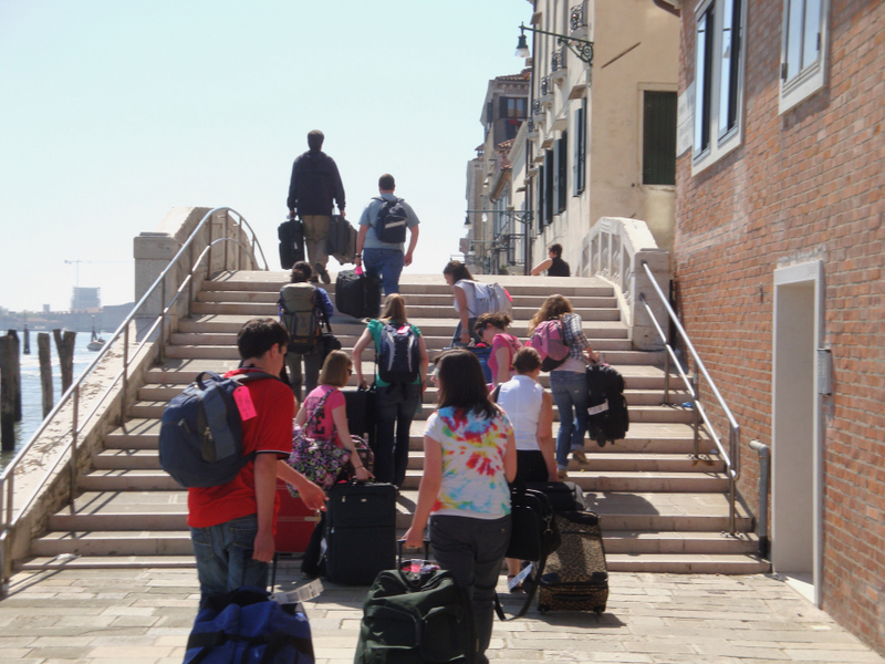 Assumption College students carrying their luggage on the way out of Venice.  Photo by Matthew Brennan.