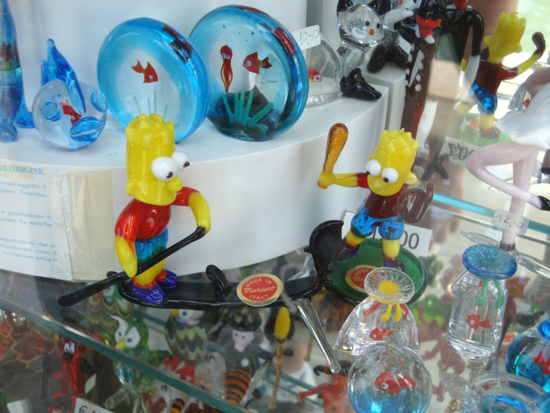 Bart Simpson riding a gondola, on display in Murano. Photograph by Matthew Brennan.