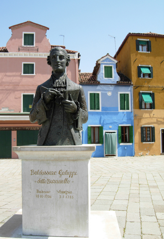 The colorful houses of Burano with the leaning tower of the San Martino Church, and the monument to composer Baldassare Galuppi (1706-1785). Photos by Dr. Beall-Fofana