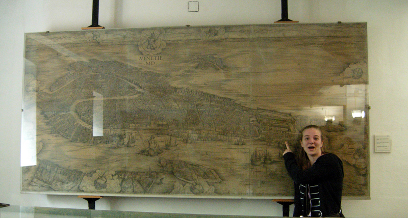 Susan Konola with a print of Jacopo de Barbaris View of Venice (c. 1500) on display at the Naval Museum.  Photo by Dr. Beall-Fofana