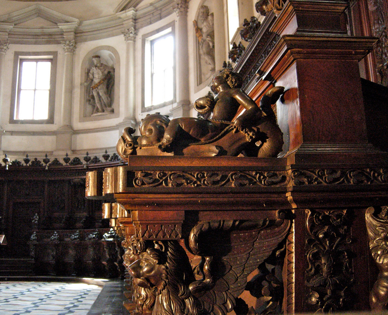 On the left is the nave of Andrea Palladio's San Giorgio Maggiore, begun in 1566 and completed in 1610 (the façade was completed by Vicenzo Scamozzi). On the right is a detail of the wood carvings in the Benedictine choir of the church. Photos by Dr. Beall-Fofana