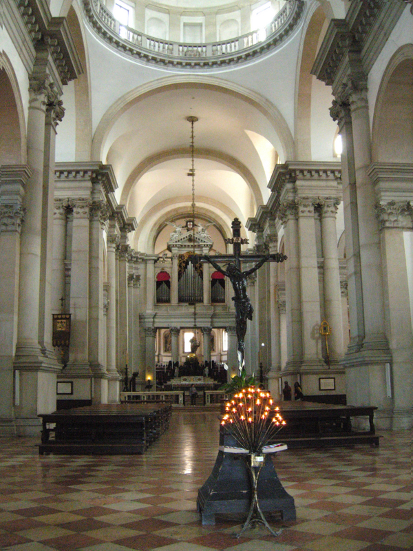 On the left is the nave of Andrea Palladios San Giorgio Maggiore, begun in 1566 and completed in 1610 (the faade was completed by Vicenzo Scamozzi). On the right is a detail of the wood carvings in the Benedictine choir of the church. Photos by Dr. Beall-Fofana