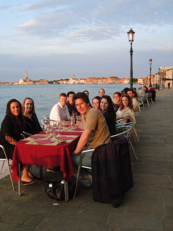 (Clockwise from top left) The Skyline Bar at the Hilton Molino Stuky. Sunset dinner on the Giudecca. The Venetian sunset during dinner. The Venetian skyline at dusk. Photos by Dr. Beall-Fofana except for the third photo, which is by Rebecca Bernard