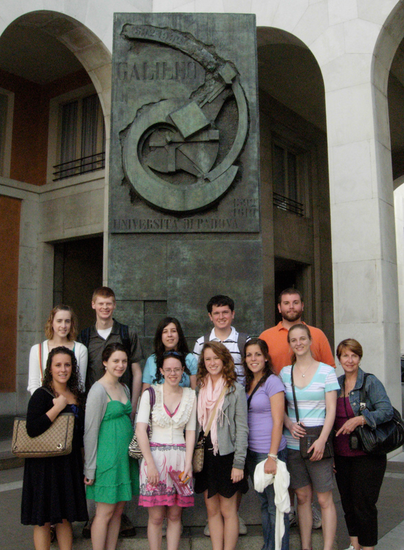 Students in front of the University of Padua and a detail of the interior courtyard where all the professors are listed in architectural shield decorations. Photos by Dr. Beall-Fofana and Dr. Patrick Corrigan.