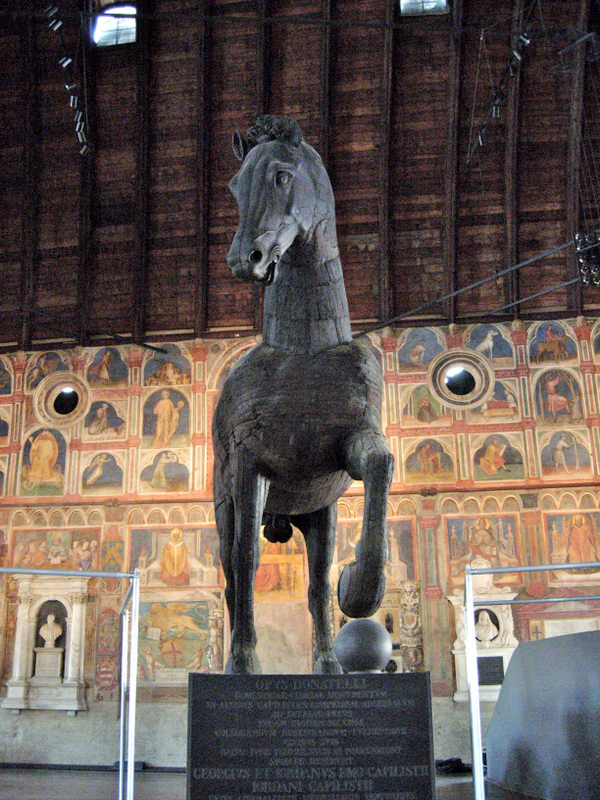 A wooden sculpture of a horse, modeled on Leonardo da Vincis original bronze design (1482-1499), in the Palazzo della Ragione (begun 1172) and an open market in Padua. Photos by Dr. Beall-Fofana.