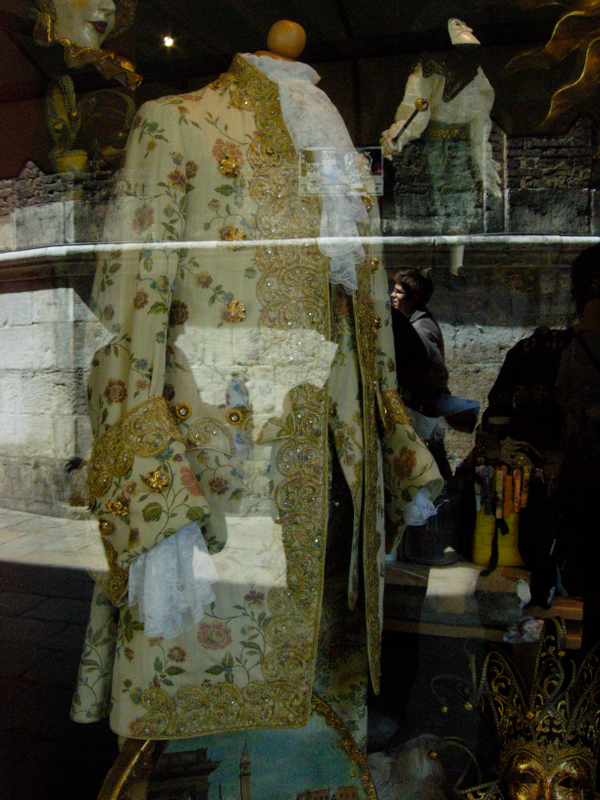 A Venetian costume on display in a shop window.  Photo by dr. Beall-Fofana.