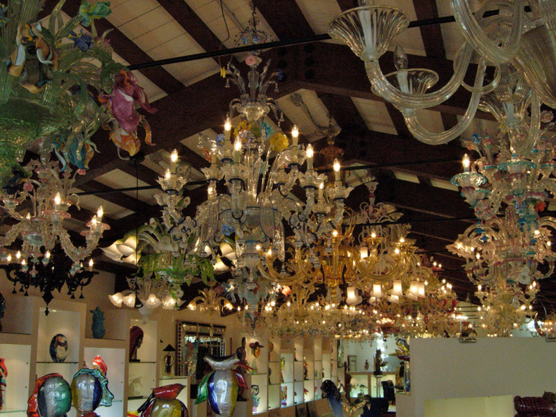A glass blowing demonstration and a gallery of glass works, including elaborate chandeliers, in Murano.  Photo by Dr. Beall-Fofana.